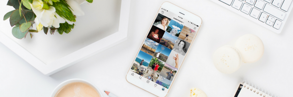 Instagram profile open on iPhone on white desk | Maker Mama
