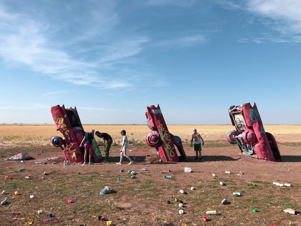 3 cars sticking out of ground at cadillac ranch amarillo