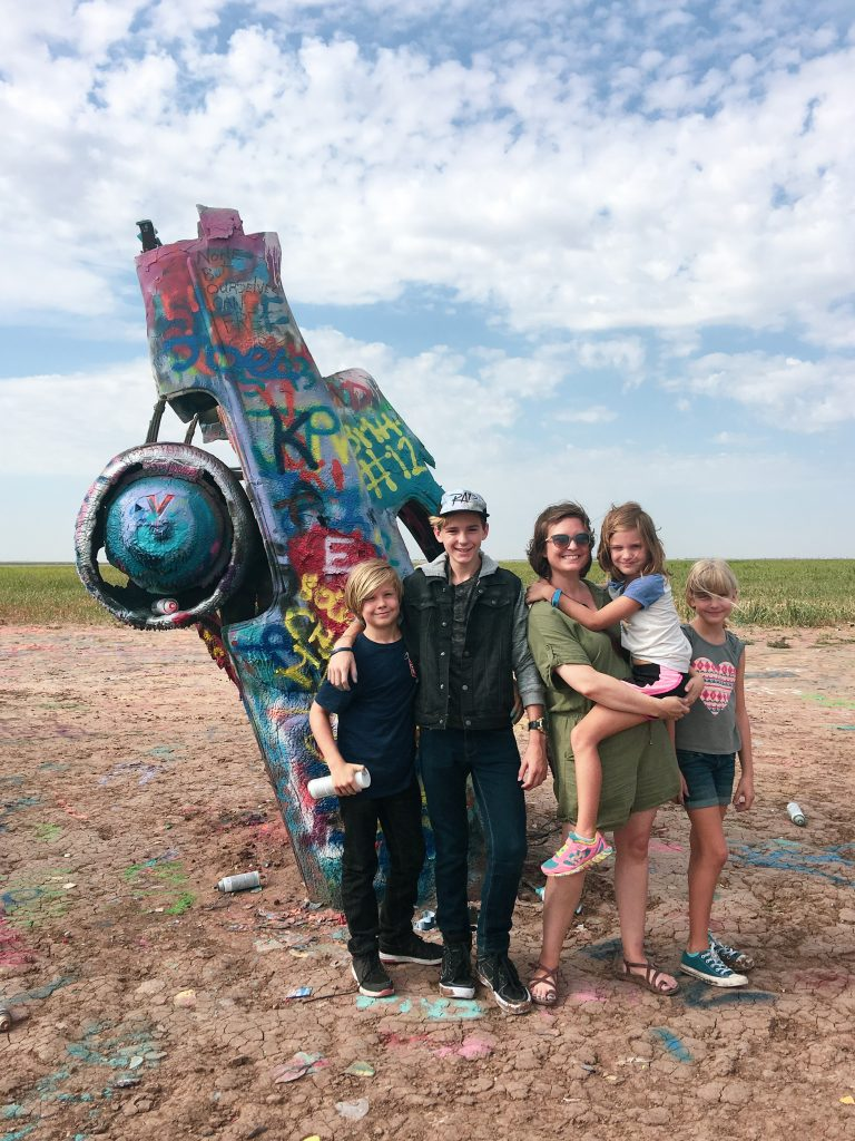 mom with four friends standing in front of car at cadillac ranch amarillo