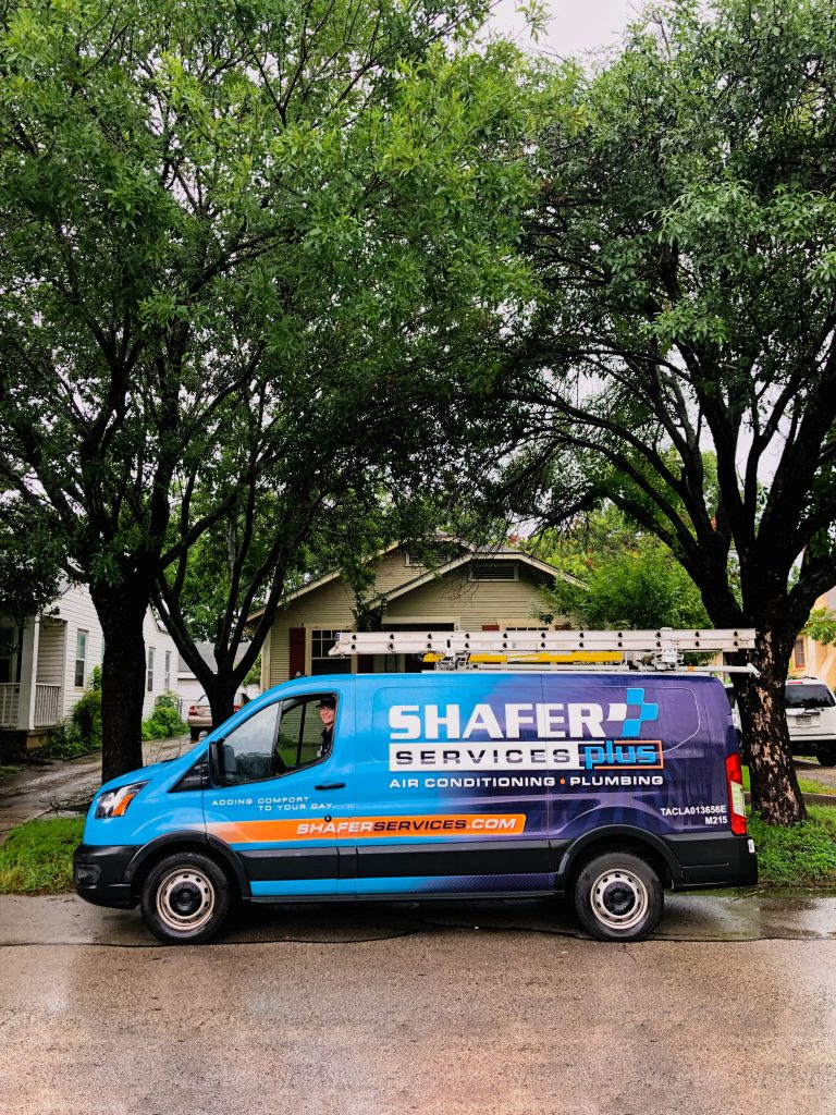 shafer services fan parked in front of house